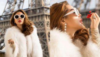 """""""Biến hình"""" với phong cách hiện đại hơn, Tina Lê lựa chọn cho mình chiếc áo lông thú sáng màu vừa đem lại vẻ ngoài trang nhã, ấm áp, vừa hiện đại, sang trọng. Cô cũng không quên mix thêm chiếc kính gọng trắng nổi bật để tạo điểm nhấn cá tính cho bộ trang phục."""